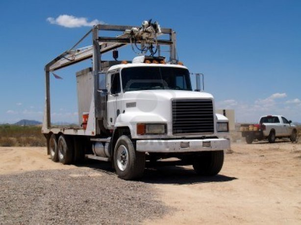 3443010-mack-truck-at-a-construction-site-with-a-smaller-work-truck-in-the-background-horizontally-framed-ph (1)